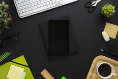 Digital Tablet Surrounded By Office Supplies On Gray Desk Royalty Free Stock Photography