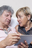Digital tablet use by couple of senior people. Royalty Free Stock Photo
