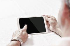 Digital tablet using by senior man Royalty Free Stock Photo