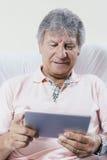 Digital tablet using by senior man Royalty Free Stock Photos