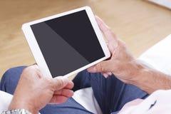 Digital tablet using by senior man Stock Photo