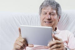 Digital tablet using by senior man Royalty Free Stock Photography