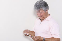Digital tablet using by senior man Royalty Free Stock Images