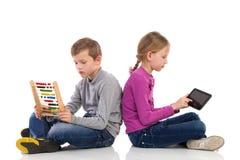 Digital tablet versus abacus Stock Images