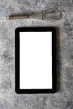Digital tablet, with whisk and antique silverware, on grunge bac Royalty Free Stock Images