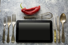 Digital tablet, with whisk and antique silverware Royalty Free Stock Photo