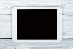 Digital tablet on the white table, office desk. Tablet can connect internet. Top view with copy space. royalty free stock images