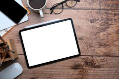 Free Digital Tablet With Blank Screen On Wooden Desk. Top View. Stock Photography - 219514882