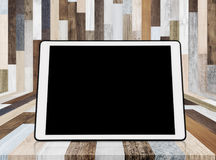 Digital tablet on wood background, with empty black screen for copy space Stock Images