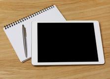 Digital-Tablette auf Tabelle Stockfotos