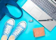 Digital technology and fashionable women's accessories on a blue background.  stock photography