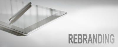 Digital teknologi för REBRANDING-affärsidé arkivbild