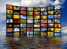 Digital television. Wall of many flat screens as concept for digital and satellite television partially immerse in water Stock Photography