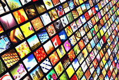 Digital television. Slanted angle wall of many flat screens as concept for digital and satellite television Stock Photography