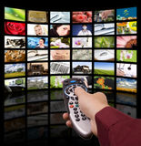 Digital television, remote control TV. Stock Photos