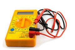 Digital tester. A yellow multimeter with corresponding probes on white background stock images
