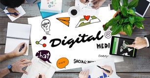 Digital text by icons and business people on table Royalty Free Stock Photos