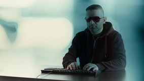 Digital thief cyber attack conception, futuristic background. Computer hacker typing on keyboard and abstract motion background stock video