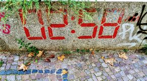 Digital time on stone. This graffito depicting  the time on stone Royalty Free Stock Photography
