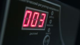 Digital timer countdown on UPS device, normal voltage. Stock footage stock footage