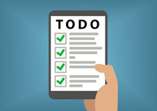 Digital todo list concept with hand holding smart phone Stock Photography