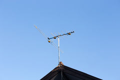 Digital TV aerial or antenna on top of  house Royalty Free Stock Image