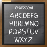 Digital vector charcoal hand drawn alphabet. On a blackboard with grid, flat style Stock Photography