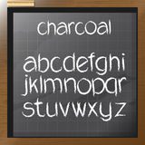 Digital vector charcoal hand drawn alphabet. On a blackboard with grid, flat style Royalty Free Stock Photos