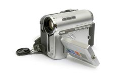 Digital Video Camera. Silver digital video recorder on a light background royalty free stock photography