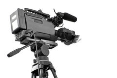 Digital video camera. High definition dvcam mounted on tripod, isolated on white stock images