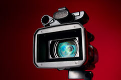 Digital video Camera. Professional video camera on a red background Royalty Free Stock Images