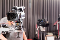 Digital video camera with lens equipment in professional media s Stock Images