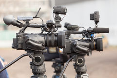 Digital video cameras covering an event Stock Images