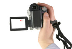 The digital videocamera. The man holds an amateur digital videocamera Royalty Free Stock Images