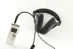 Digital voice recorder and headphone. Stock Image