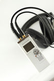 Digital voice recorder and headphone. Royalty Free Stock Image