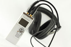 Digital voice recorder and headphone. Royalty Free Stock Images