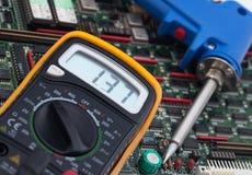 Digital Voltmeter and PCB Royalty Free Stock Photos