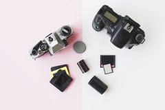 Digital vs. Analog SLR Camera with Slides, Memory Cards, 35 mm Film royalty free stock photo