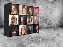 Digital wall with portraits Stock Images