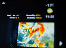 Digital weather forecast interface on a modern digital display. Showing cold weather for the next day eaturing an unrecognizable weather map. Tilt-shift lens royalty free stock image