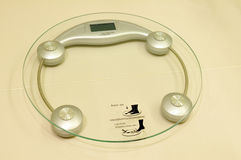 Digital weight scale. On floor royalty free stock photography