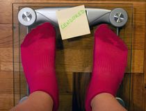 Digital weight scale with post it note royalty free stock images
