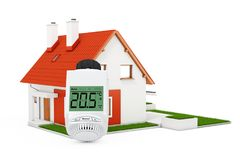 Digital Wireless Radiator Thermostatic Valve near Modern Cottage Stock Photography