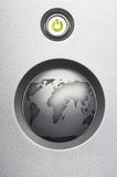Digital world. On/off button with green  lighted LED and a bigger button with a worldmap on it Stock Photos