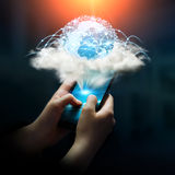 Digital world in a cloud connected to businesswoman mobile phone. Cloud and digital world connected over businesswoman mobile phone Royalty Free Stock Photos