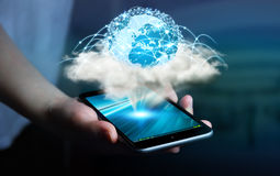 Digital world in a cloud connected to businesswoman mobile phone Stock Photos