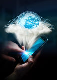 Digital world in a cloud connected to businesswoman mobile phone Royalty Free Stock Photography