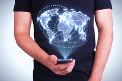 Digital world map interface. Businessman holding cellphone with digital world map interface Stock Photo