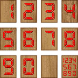 Digital-Zahlen des Plastiks auf der Oberfläche des Holzes Lizenzfreie Stockfotografie